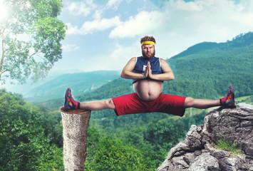 Overweight man doing splits