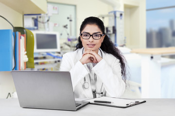 Beautiful indian doctor in the workplace