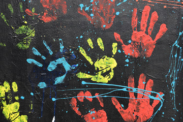 messy handprints dripping paint