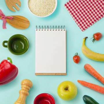 Food background with blank notebook. View from above