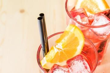 Fototapete - glass of spritz aperitif aperol cocktail with orange slices ice