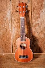 ukulele on old wooden