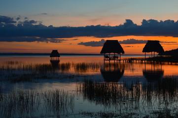 Poster Crimson Sunset at the lake Peten Itza in El Ramate