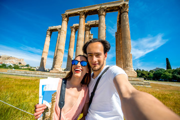 Young couple taking selfie picture with Zeus temple on