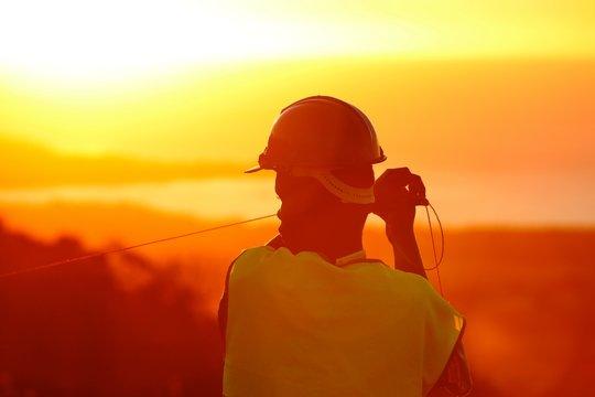 Man at work sunset