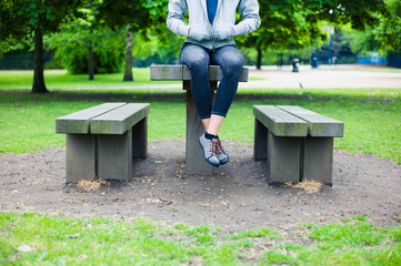 Woman sitting on table in park