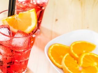 Fototapete - glass of spritz aperitif aperol cocktail with orange slices