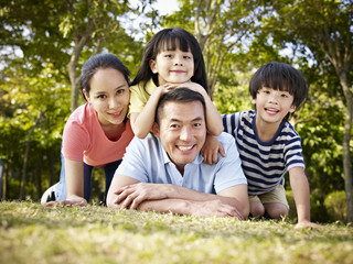 happy asian family in nature