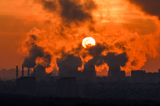 Sunset through the smoke and steam cogeneration station