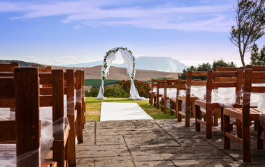 a wedding arch against a outdoor landscape