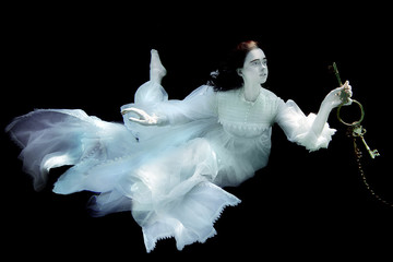 Woman Underwater Wearing White Gown