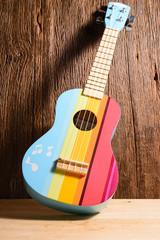 Colorful Ukulele on wood background