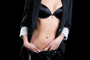 Torso of girl in jacket and bra