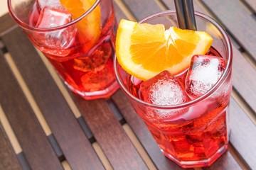 Fototapete - view of glasses of spritz aperitif aperol cocktail and orange
