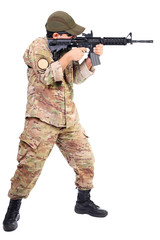 Young soldier or sniper aiming with a rifle