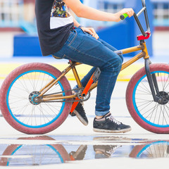 close-up of teenager on a fashionable bike at outdoor