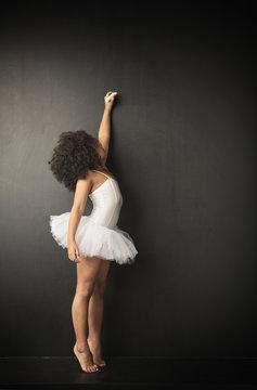 Little ballet dancer making drawings