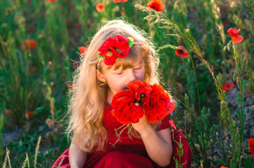 beautiful blond child with poppy flowers