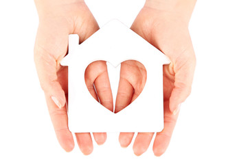 Female hands with model of house isolated on white