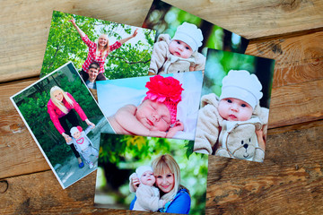 Printed photos on wood background