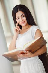Happy woman reading book student univatsity