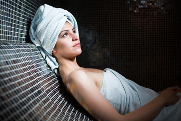 Spa woman.Wrapped in towels.Perfect smooth young exfoliated skin