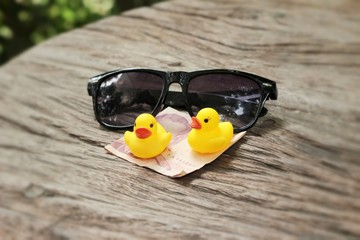 yellow rubber duck and black sunglasses