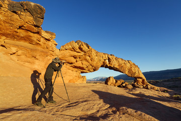 Photographer at Sunset Arch, Grand Staircase Escalante NM, Utah