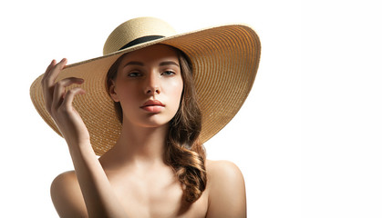 Young woman in summer straw hat on a white background isolated