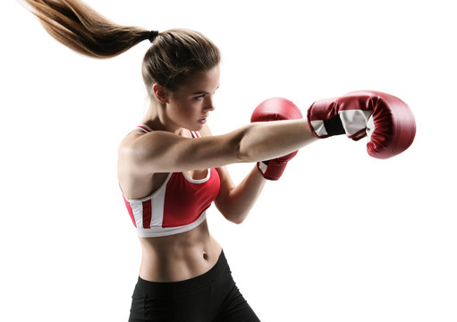 Boxer woman during boxing exercise making direct hit with  glove