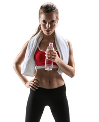 Beautiful girl with towel and bottle of water