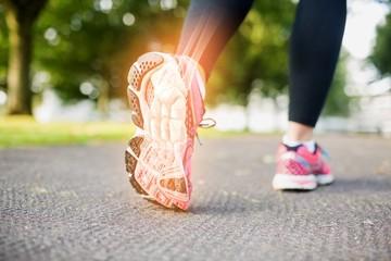 Highlighted foot bones of jogging woman