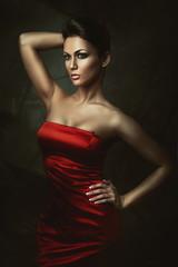 beautiful brunette woman in red dress