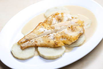 fried halibut with sweet potatoes and lemon sauce