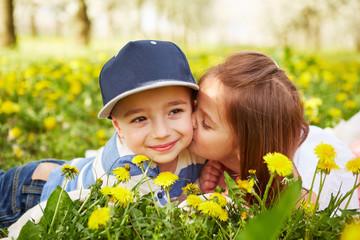 Girl kissing a boy