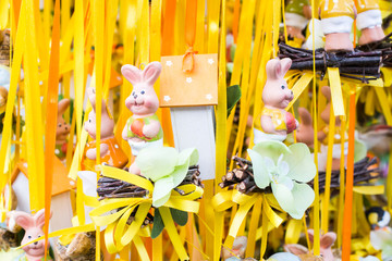 Funny Easter rabbits figurines in a market