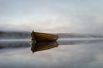 Scenic view of boat in lake against sky