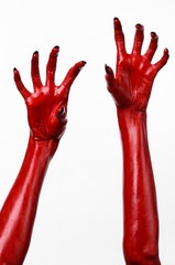 Red Devil's hands, red hands of Satan, white background isolated