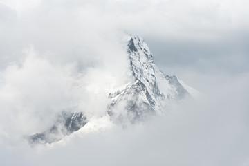 Switzerland, Valais, Zermatt, Matterhorn mountain seen through clouds