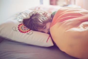 Sleeping boy (6-7) in bed