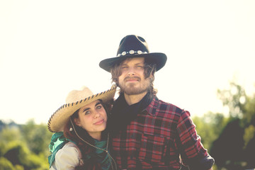 Portrait of cowboy and cowgirl couple in field