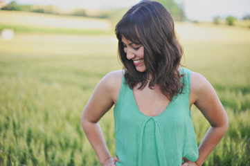 Piemonte, Italy, Smiling Girl Dressed In Green In A Field