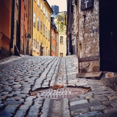 Sweden, Svealand, Stockholm,  Manhole cover in cobbled street