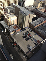 USA, California, San Francisco, Rooftop car park and city buildings
