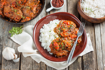 beef in a spicy tomato sauce with rice