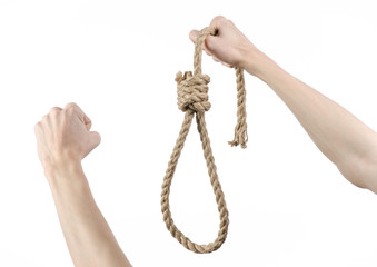 man's hand holding a loop of rope for hanging on isolated