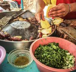 Close up of man's hand preparing food on street stall