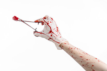 doctor bloody hand in glove holding a surgical clamp with swab