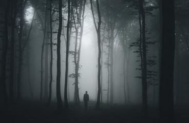 Fototapeten Wald spooky halloween scene with man in dark forest