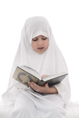 Little Young Muslim Girl Reading Quran